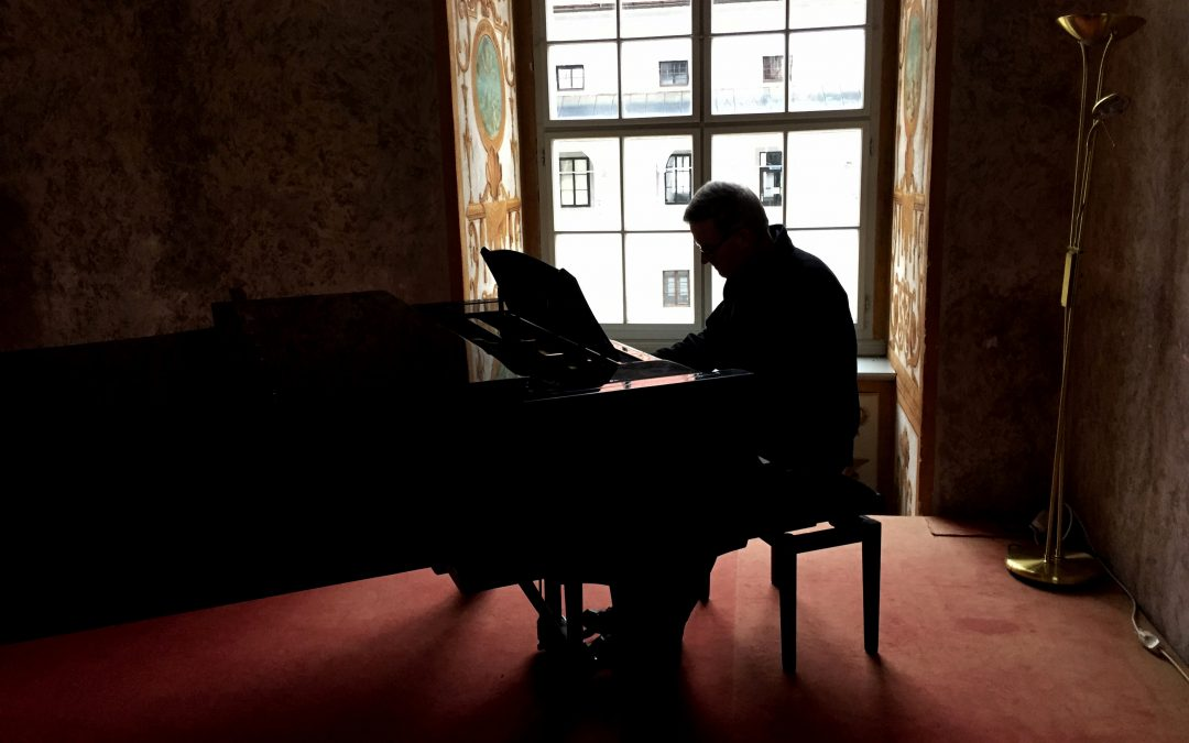 Fr. Quinlivan playing piano in Austria